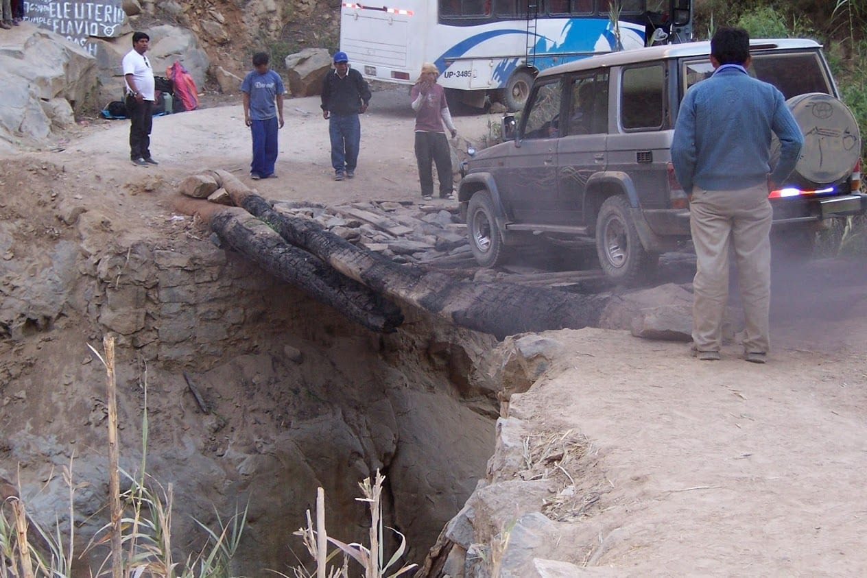 4WD crossing dodgy bridge in Peru