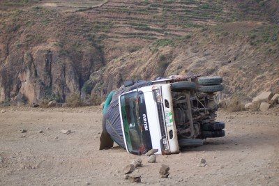 An overturned car seen when cycling the Blue Nile Gorge in Ethiopia