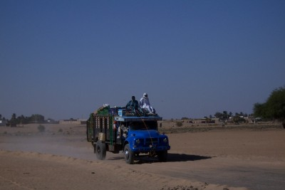 A truck moving through the desert in Sudan