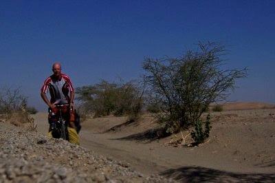 Dave Briggs cycling in the Sudan desert near the Nile