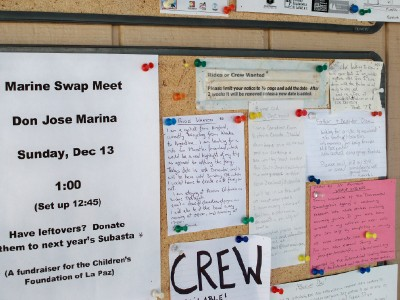 Checking out the notice board at the marina in La Paz, Mexico for a free yacht ride