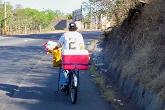 Racing a local when cycling in El Salvador