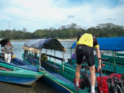 Loading the bicycles onto lanchas for the river crossing