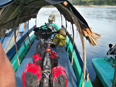 Loaded touring bikes on a river lancha in Guatemala