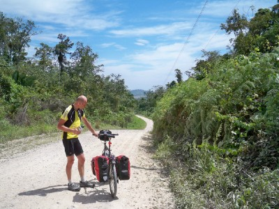 Oliver taking a break when cycling from Bethel to Flores