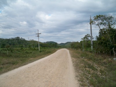 Cycling along a rough little road in Guatemala