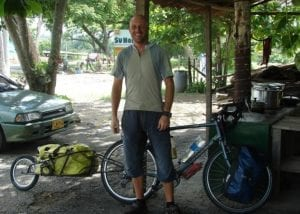 Dave Briggs cycling in Colombia with a Bob Yak trailer