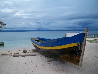 Colourful fihsing boat and amazing waters of the San Blas islands near Panama