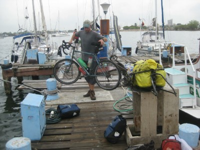 Unloading my bicycle and trailer after arriving by boat in Colombia.