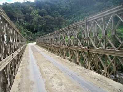 Crossing the bridge by bicycle at Isimanchi in Ecuador