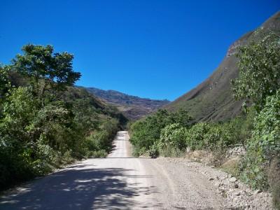 Cycling along the dirt road towards Leymebamba in Peru