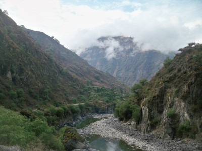 Cycling out of a village in Peru, and into the clouds!