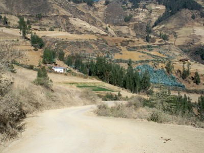 Cycling out of Santiago de Chuco in Peru on yet another sandy road.