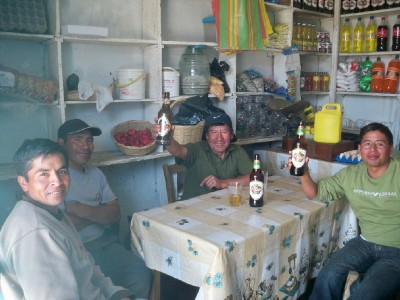 Having a drink with the locals in Pallasca Peru