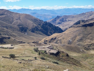 Cycling past some remote farms in the Andes of Peru