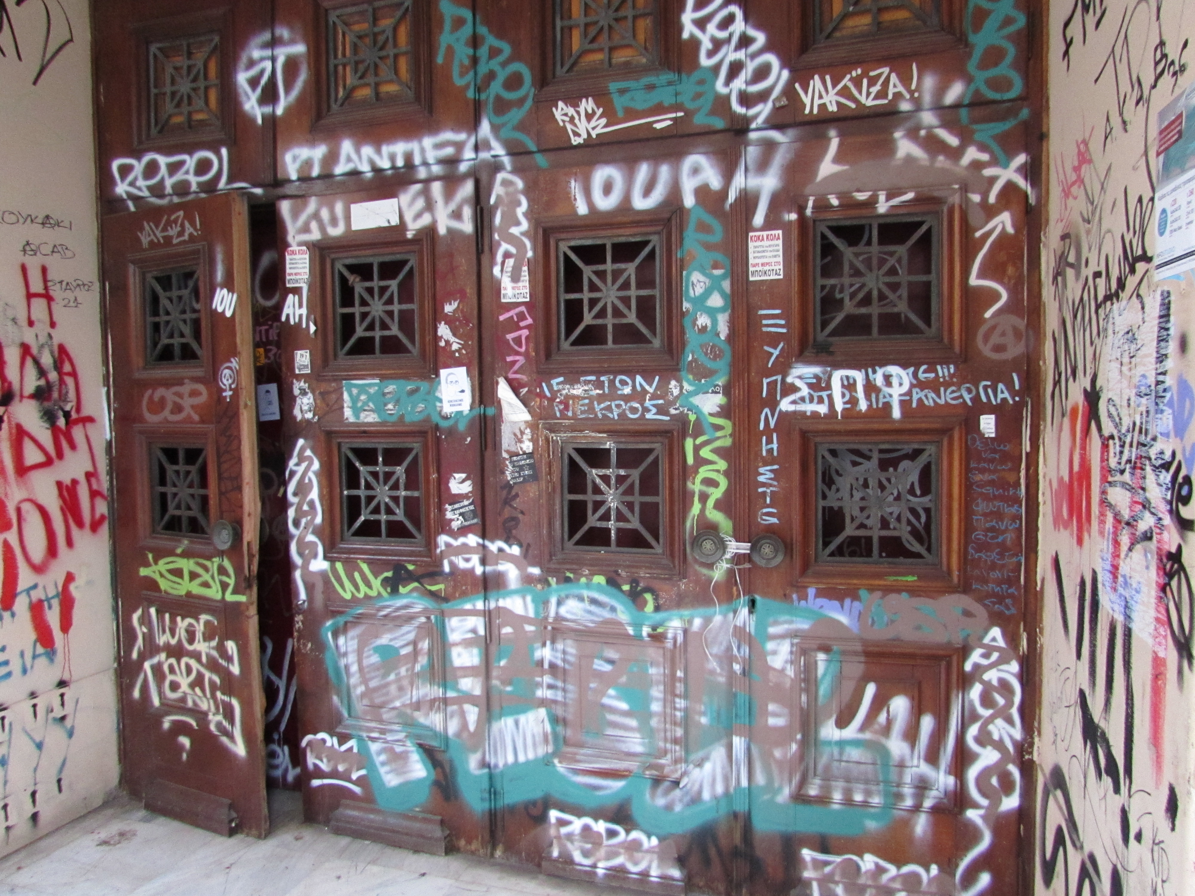 Graffiti on a door at Athens Polytechnic