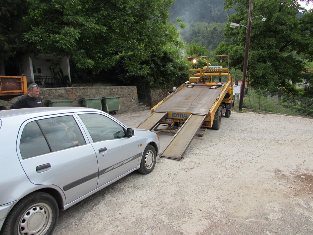 Our car being towed in Greece