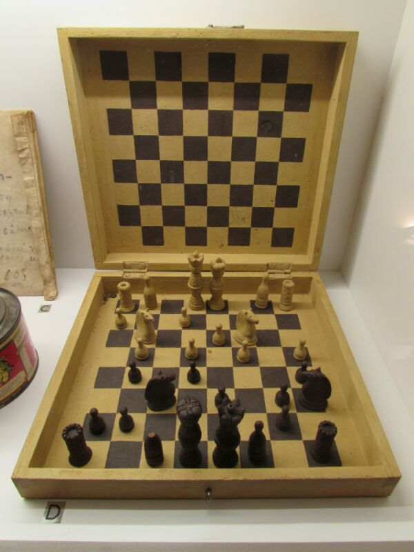Chess board in the Ai Stratis Political Exile Museum. The pieces are made of bread.
