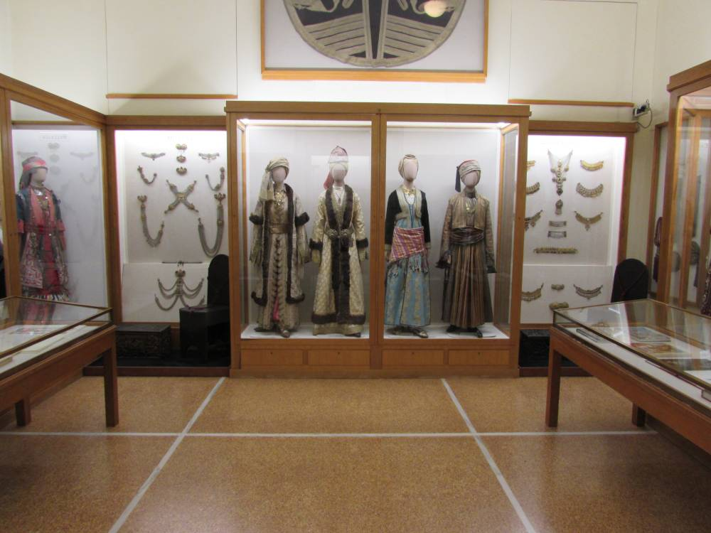 Greek national costumes on display inside the National Historic Museum in Athens Greece