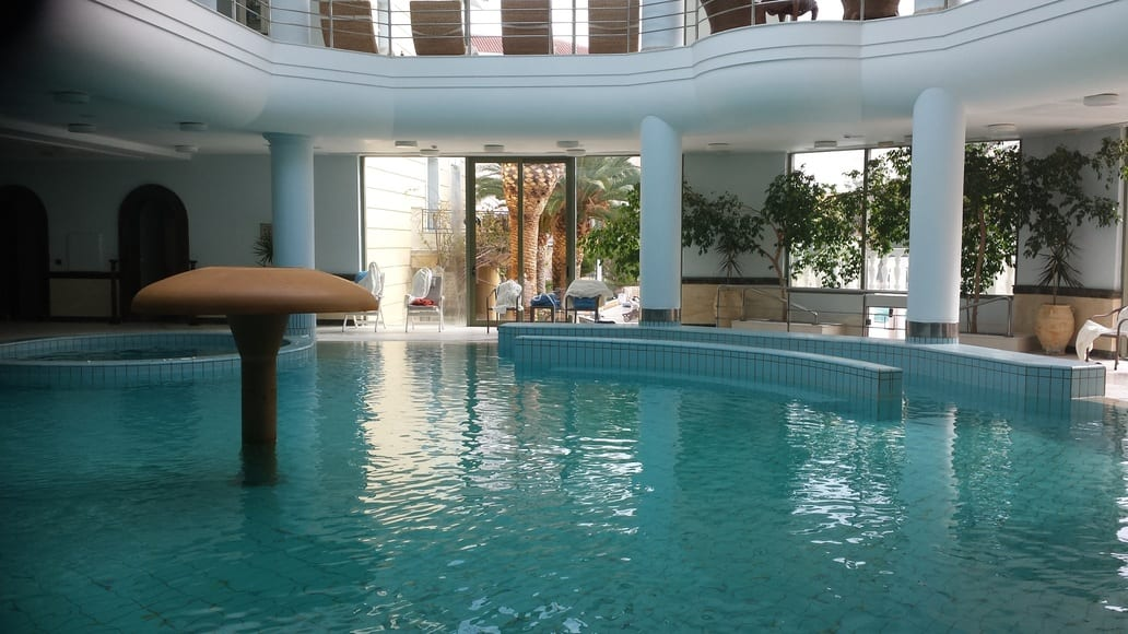 Relax and unwind in the indoor spa pool at the Thermae Sylla Spa and Wellness Hotel in Greece