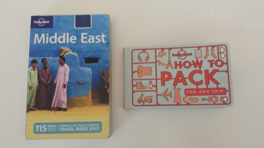 Comparing How To Pack For Any Trip with a standard size Lonely Planet Book