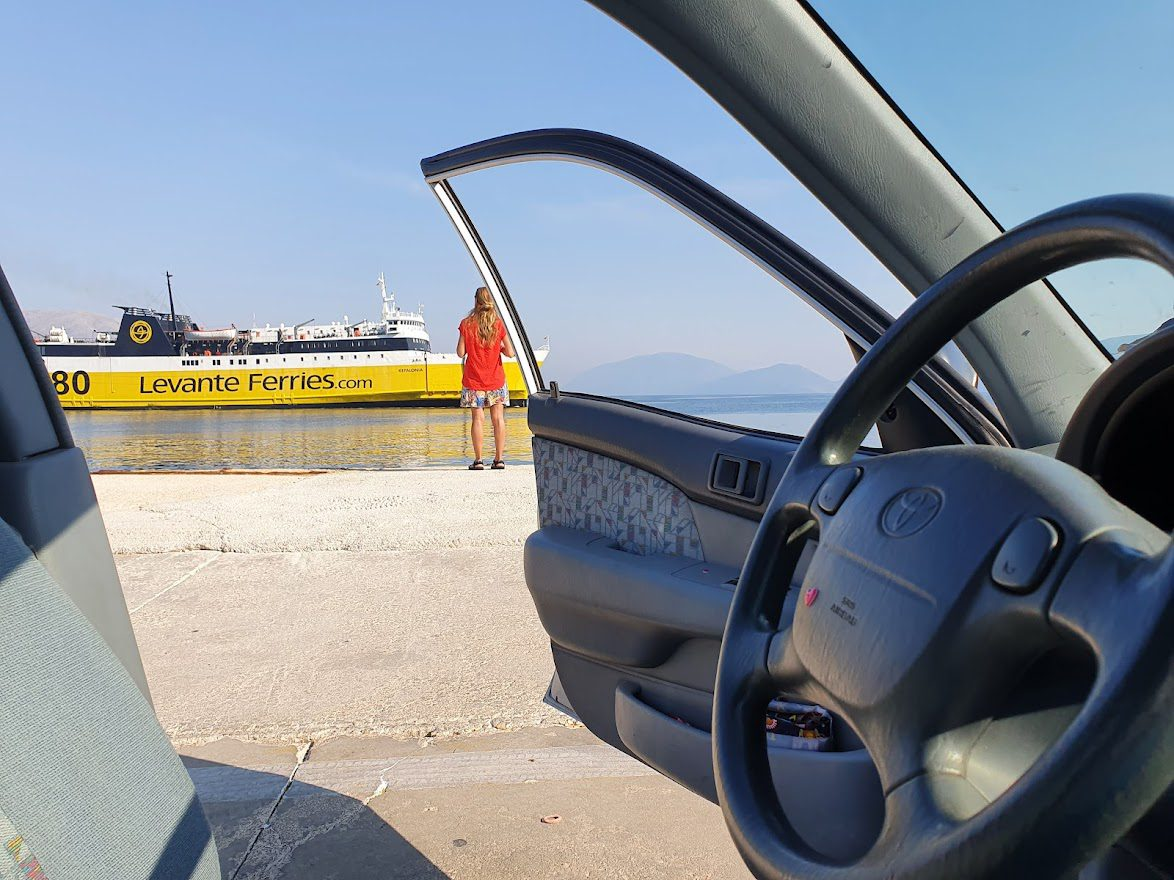 Seeing Greece by car and waiting for a ferry in Patras port