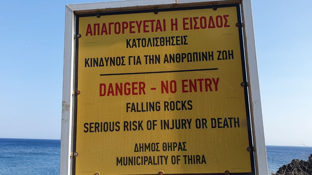 Danger of rockslides at Red Beach in Santorini Greece