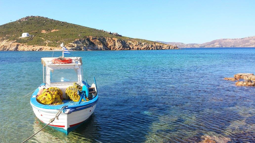 A boat floating in a quiet bay in Patmos