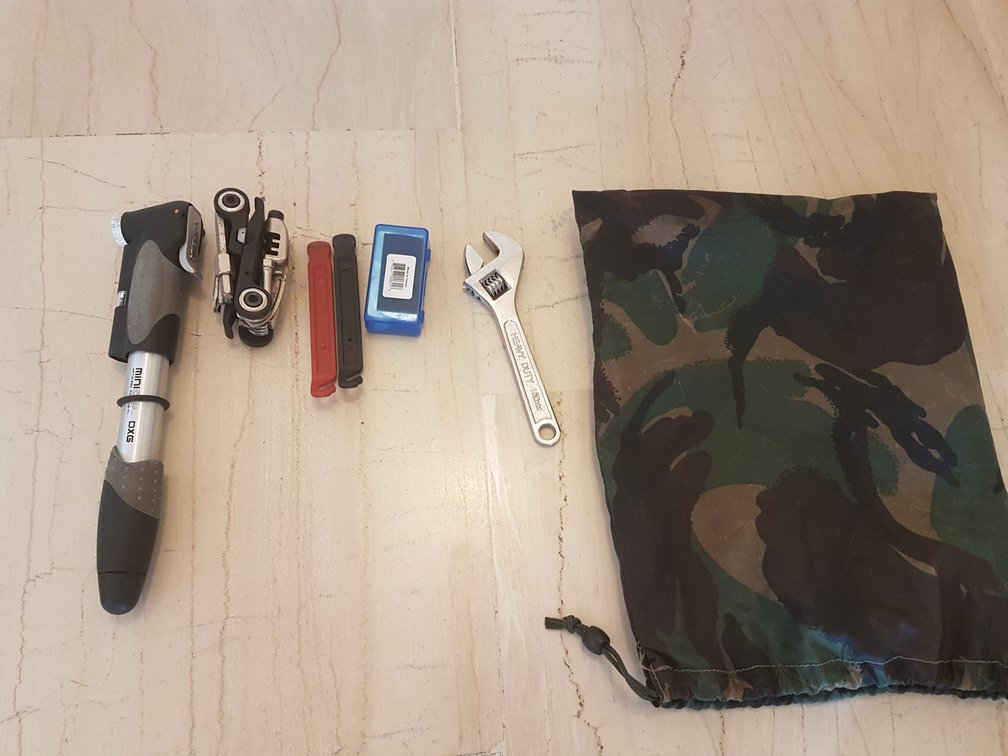 My current bike touring tool kit includes a multi tool as well as various dedicated bits of kit.