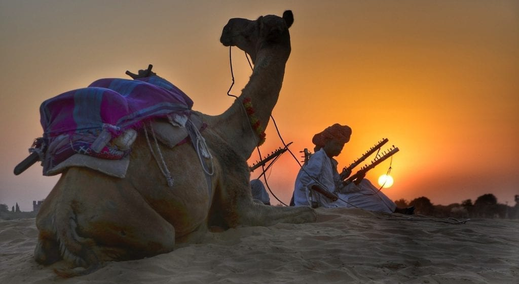Taking a camel safari near Jaisalmer in India