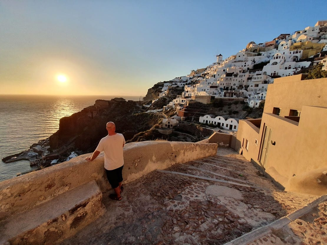 Dave from Dave's Travel Pages enjoying a July sunset in Santorini