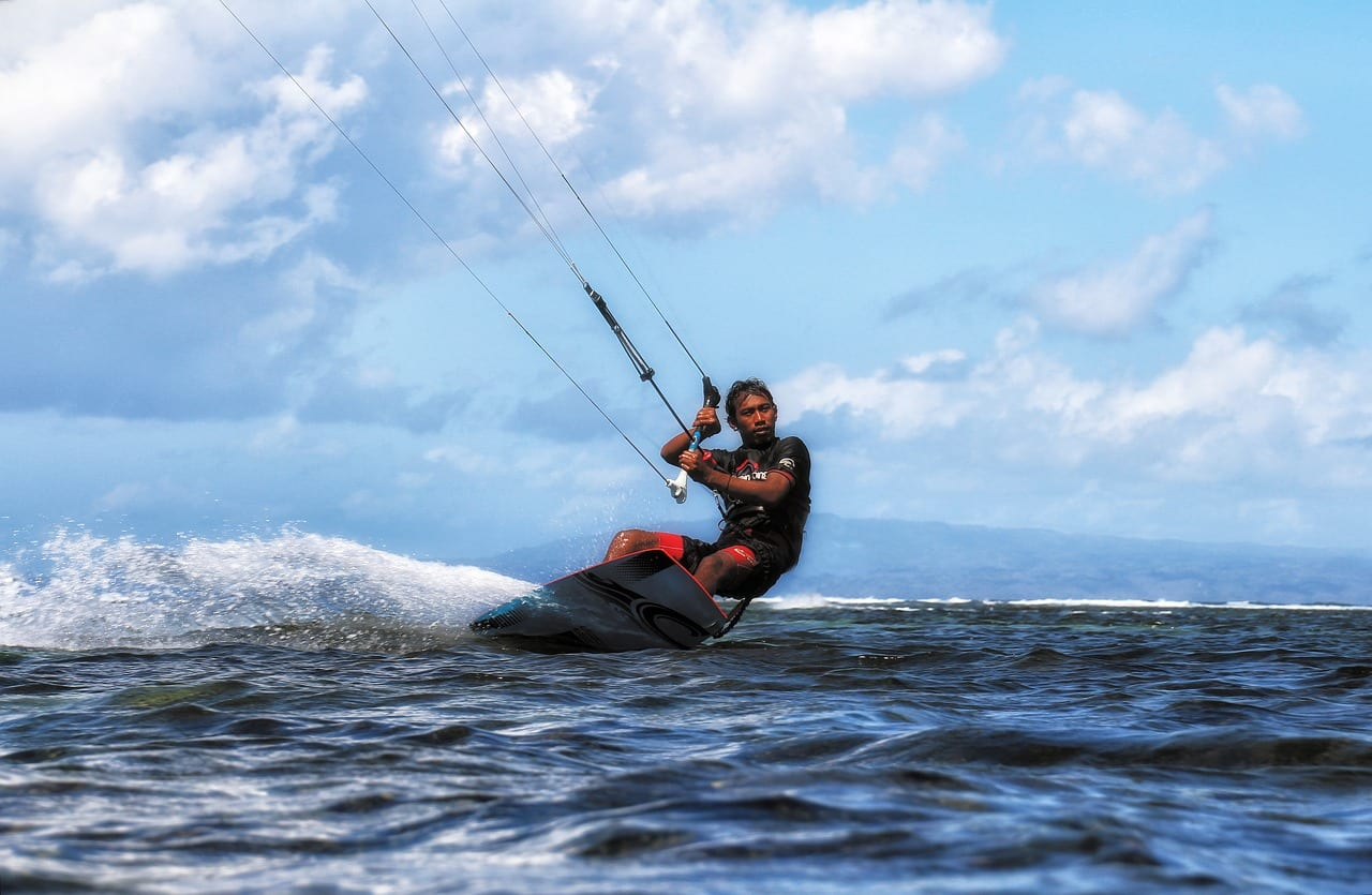 Kite surfing in Bali is a popular water sport you can try when on vacation