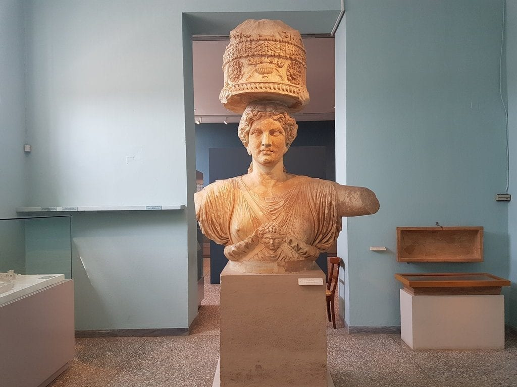 Female statue at Elefsina carrying something on her head