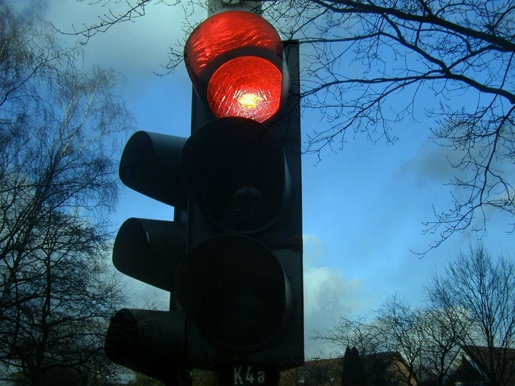 If you want to cycle safe on a bike tour, then remember to stop at red traffic lights!