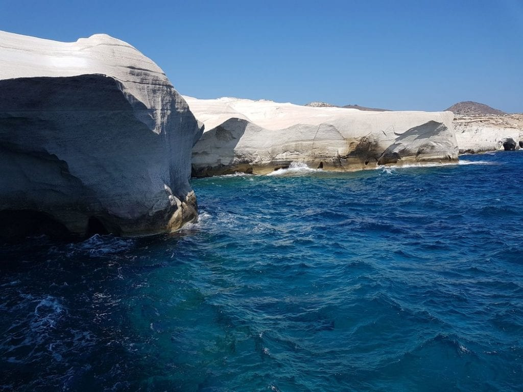 The beautiful white beach of Milos contrasted against the stunning blue of the Greek sea.