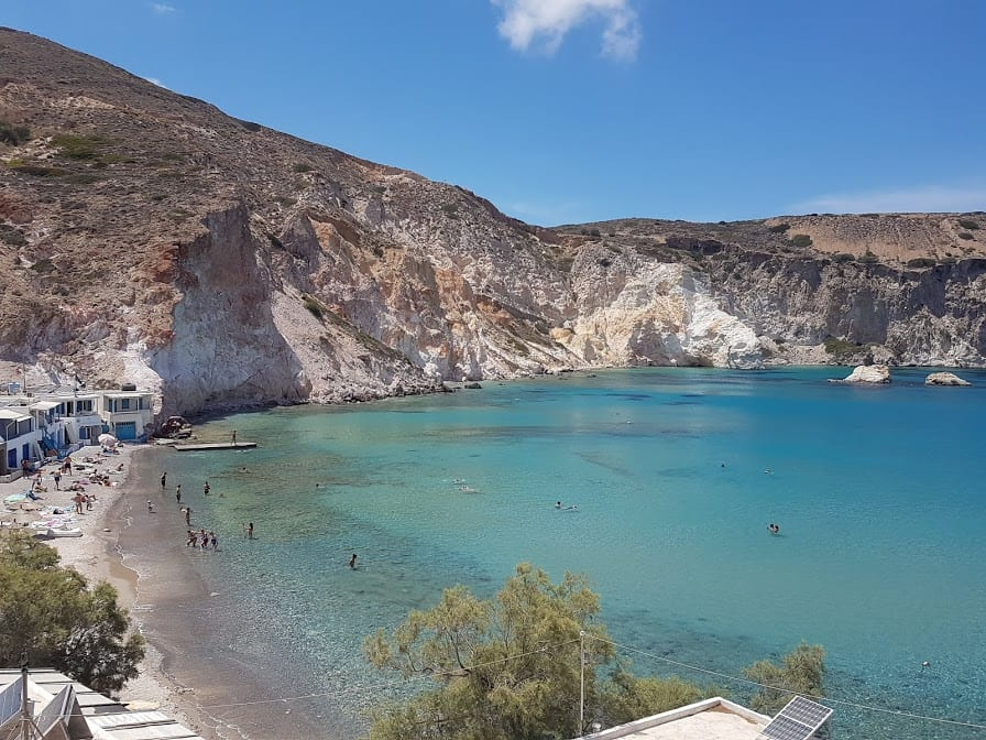 People swimming at Firopotamos beach in Milos island