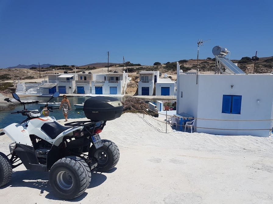 A quad bike parked outside a small coastal village in Milos