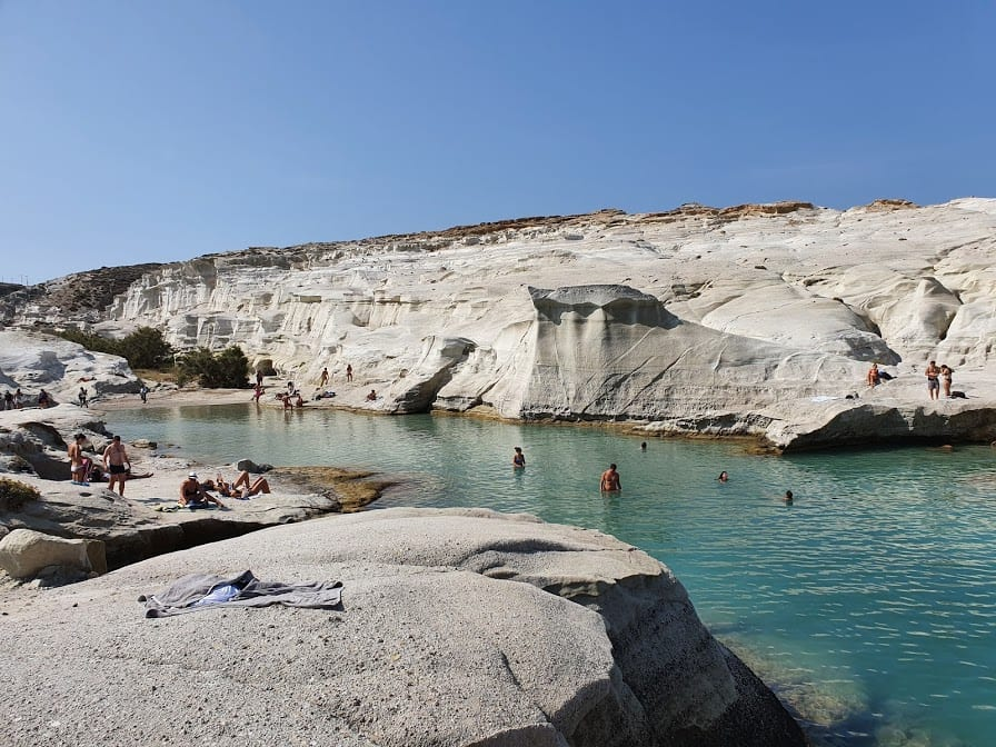Swimming at Srakiniko Beach in Milos island Greece