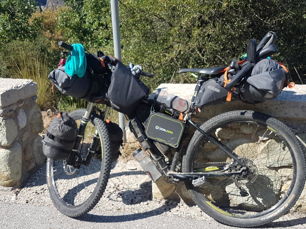 A bikepacking setup with front handlebar roll bag