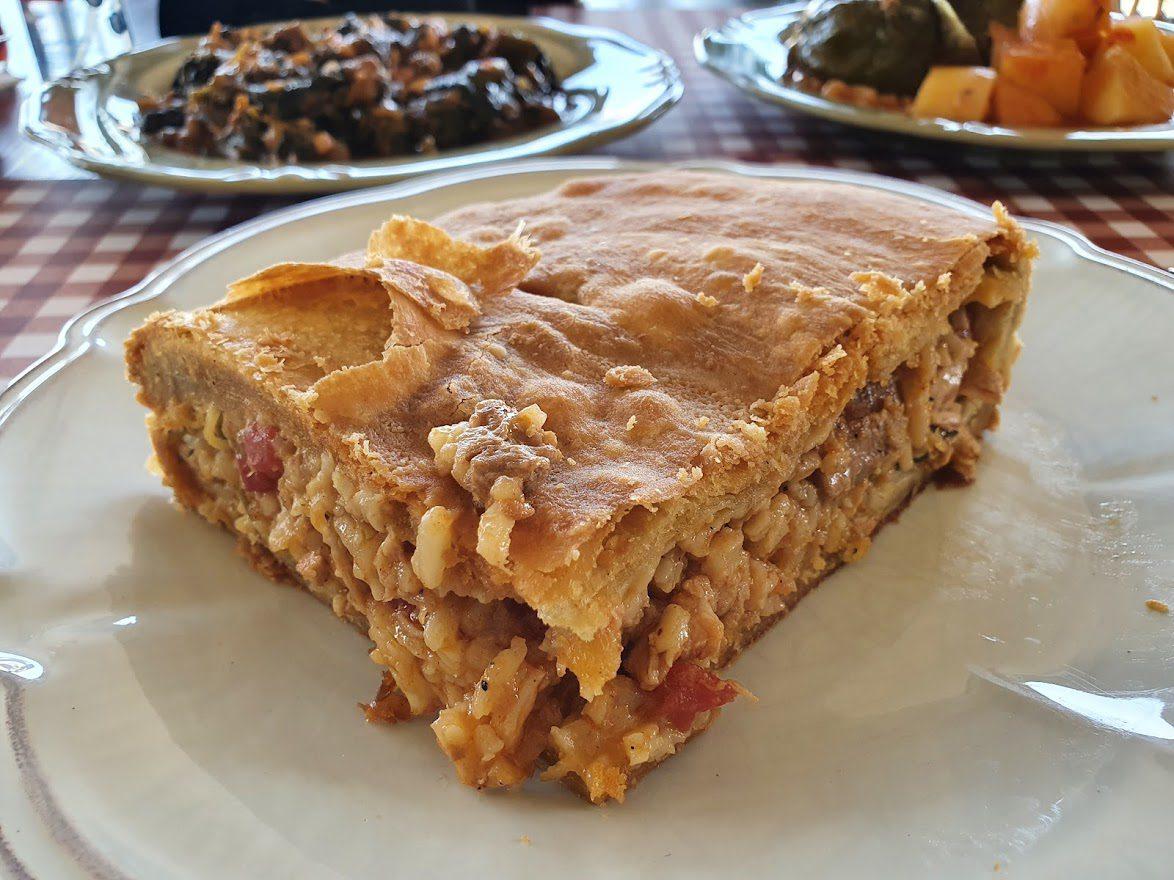 A large slice of Kefalonian Meat Pie