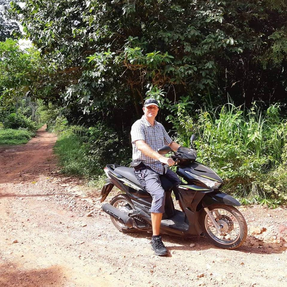 Dave on a moped in Thailand