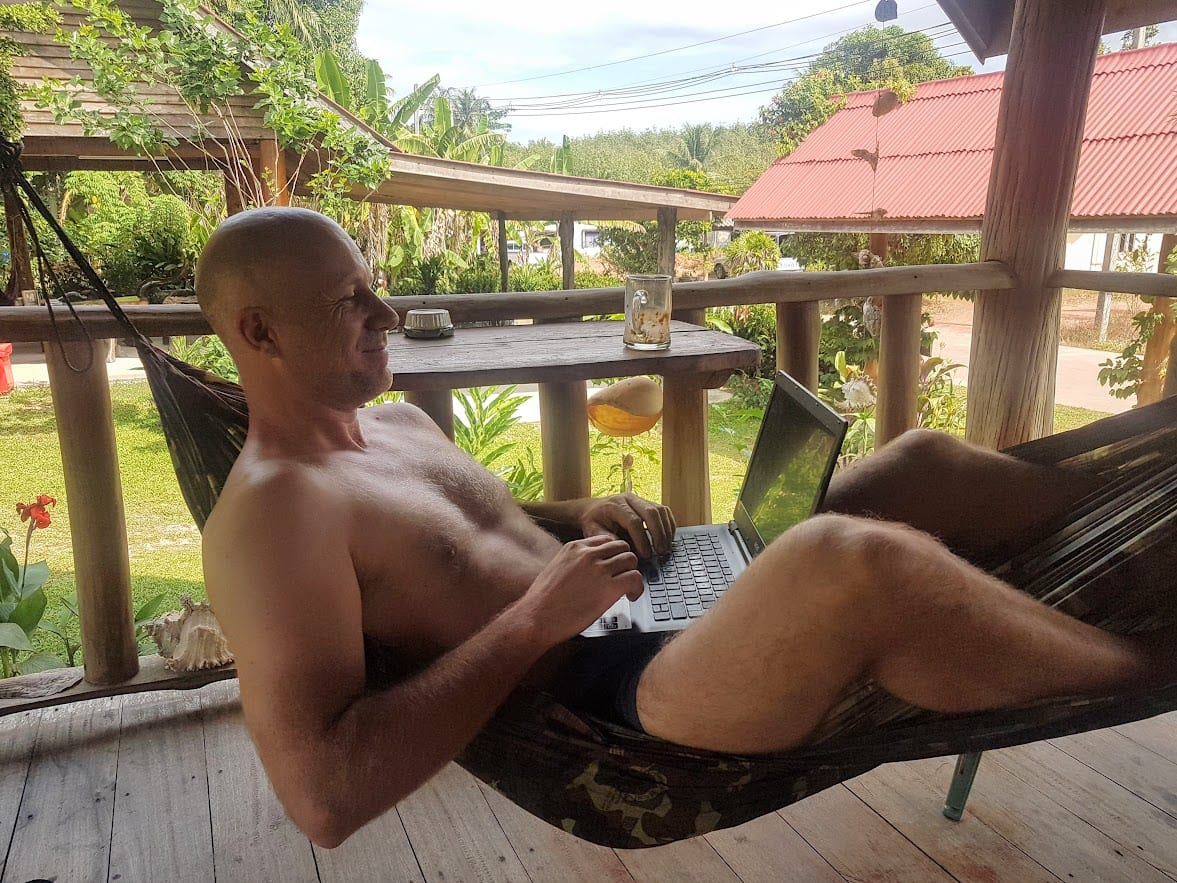 Dave Briggs working in a hammock