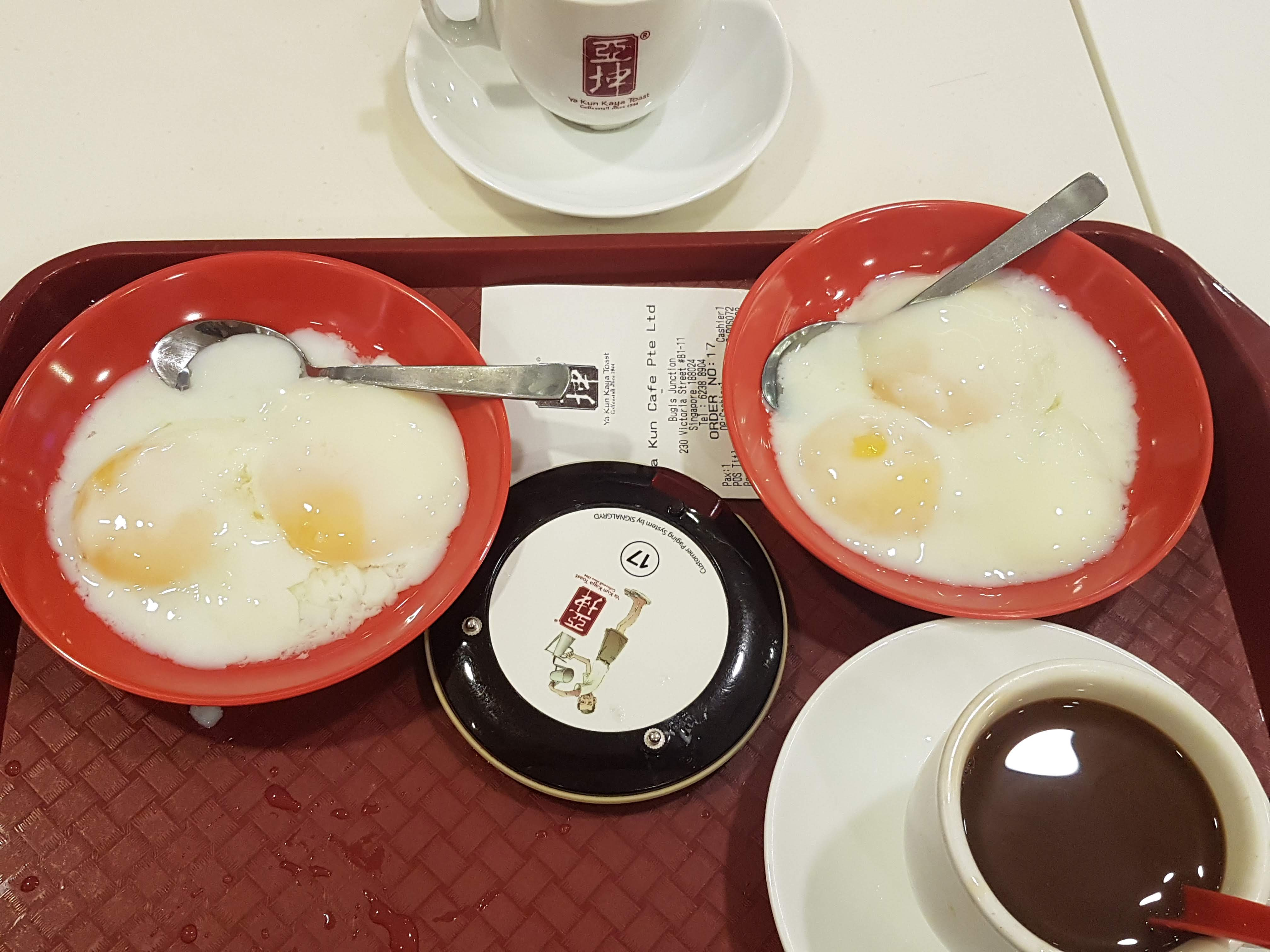 A traditional breakfast of runny eggs in Singapore