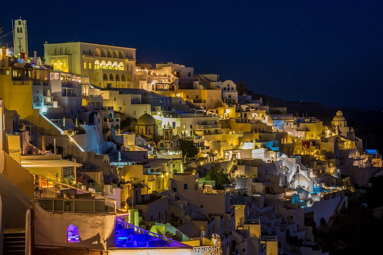 An view out over Santorini during the evening. Santorini is a must visit when planning a Greek island itinerary.