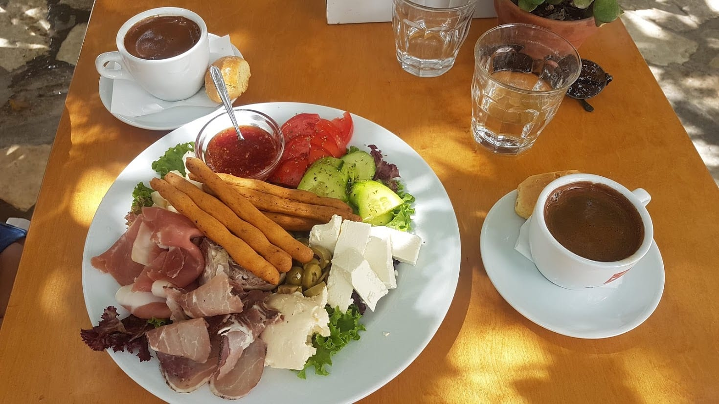 Traditional Greek coffee and a meze of food