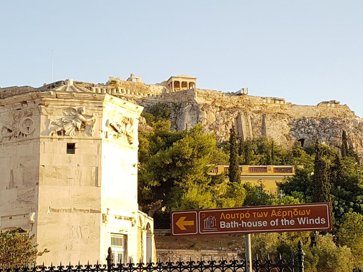 A sign pointing to the bath House of the Winds in Athens Greece