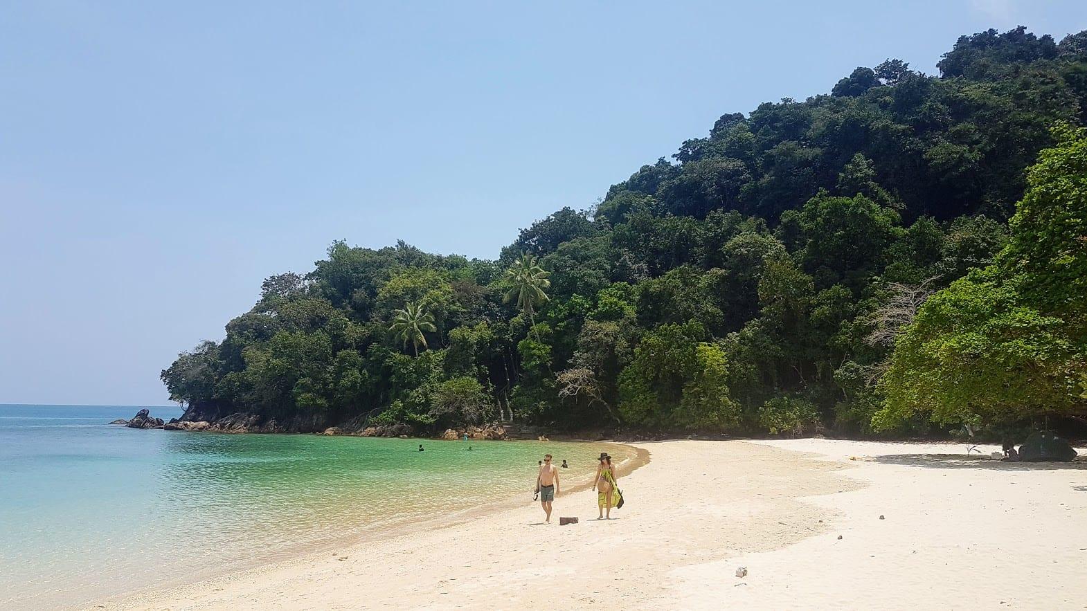 Walking along the beach in Kapas Island Malaysia
