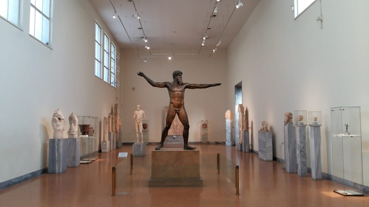 Make sure to visit the National Archaeological Museum in Athens in winter to see magnificent statues such as this bronze of either the God Zeus or Poseidon.