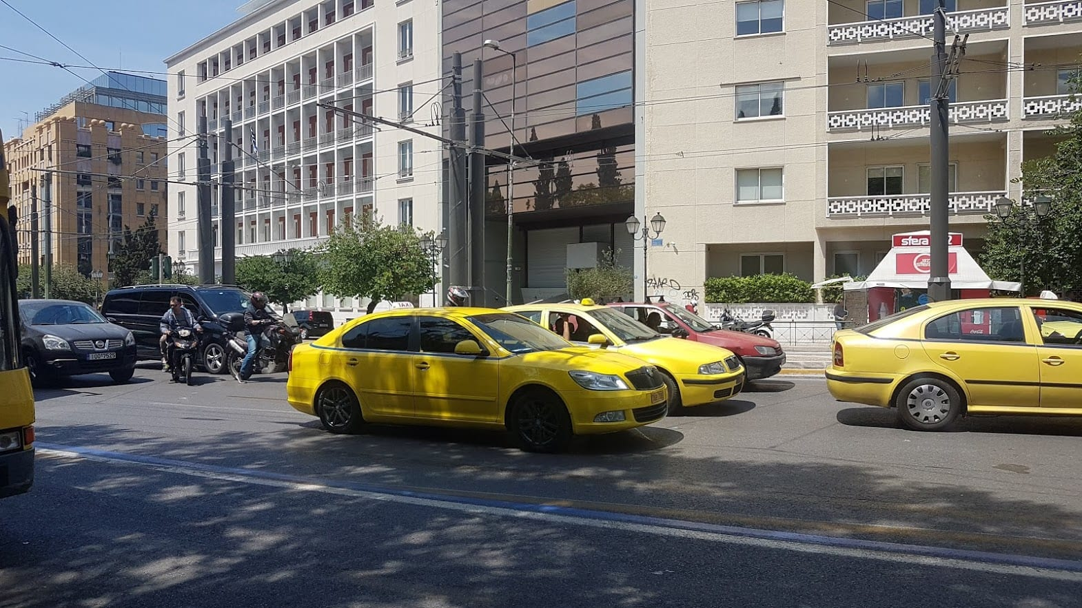 The yellow taxis in Athens