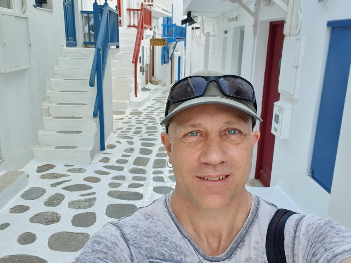 Dave from Dave's Travel Pages walking the empty streets in Mykonos Town in Spring